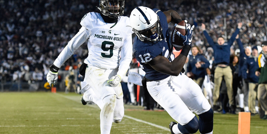 Nov 26, 2016; University Park, PA, USA; Penn State Nittany Lions wide receiver Chris Godwin (12) runs with the ball into the end zone for a touchdown in front of Michigan State Spartans safety Montae Nicholson (9) during the third quarter at Beaver Stadium. Mandatory Credit: Rich Barnes-USA TODAY Sports